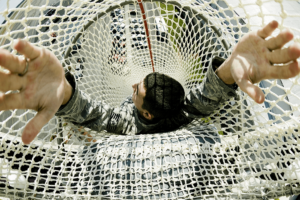 A soldier sliding in a net slide