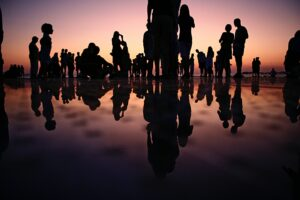 Silhouette picture of people with reflections